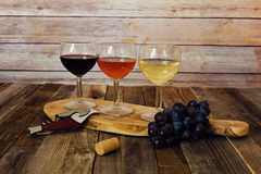 Wine flight with grapes, cork and bottle opener Royalty Free Stock Photography