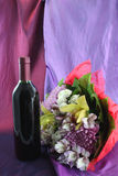 Wine and flowers Stock Image