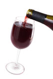 Wine flows in  wine glass Stock Image