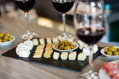 Wine and food arranged on table stock image