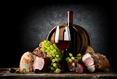 Wine and food on black Royalty Free Stock Photos