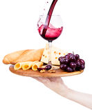 Wine and food with waiter hand Royalty Free Stock Photography