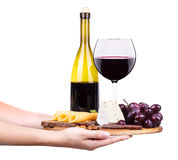 Wine and food with waiter hand Royalty Free Stock Photos