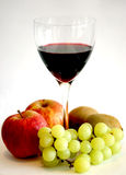 Wine and fruit. A glass of red wine and some fruit royalty free stock photography