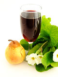 Wine and fruit. Red Wine, pear and flowers Stock Images