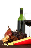 Wine, Fruit and Cheese. Red wine, with board of cheese, grapes, figs, pear and walnuts. White background stock photo