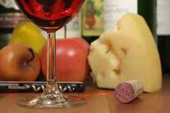 Wine Fruit & Cheese. This is an image of wine, fruit, and cheese stock photo