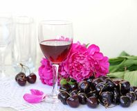 Wine, fruit and flowers royalty free stock image