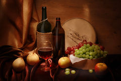 Wine and fruits Stock Images