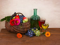 Wine, fruits and flowers Stock Photos