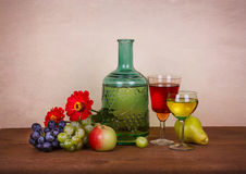 Wine, fruits and flowers Stock Images