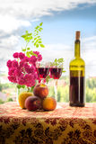 Wine and fruits. Still life with wine, roses and fruits Royalty Free Stock Photography