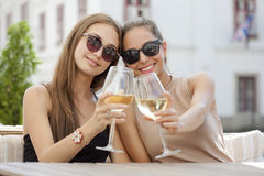 Wine fun with friends. Portrait of two young beautiful women having some wine Royalty Free Stock Photos