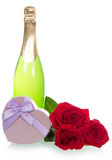 Wine, gift and roses Royalty Free Stock Photography