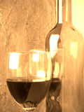 Wine and glass. Wine bottle and glass in sepia Stock Photography