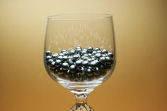 Wine glass. With small metal beads Stock Photo