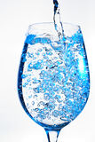 Wine glass. Water pouring into a wine glass Royalty Free Stock Photo