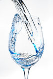 Wine glass. Water pouring into a wine glass Royalty Free Stock Photos