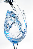 Wine glass. Water pouring into a wine glass Stock Photography
