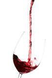 Wine glass. Pouring red wine into a crystal wine glass Stock Images
