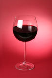 Wine glass. Over a gradient background royalty free stock photos