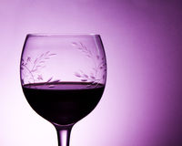 Wine Glass. A glass full of wine with a star and leave pattern on the glass Stock Image