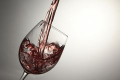 Wine Glass. Red wine pouring into wine glass royalty free stock photos