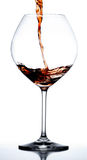 Wine Glass. Red wine being poured into glass stock images