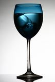 Wine glass. An isolated blue wine glass with ice water Royalty Free Stock Images