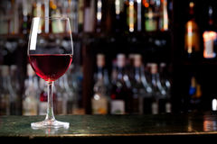 Wine glass. On the background of the bar royalty free stock photo
