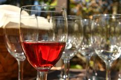 Wine glass. Glass of wine with empty glasses in background Stock Photo