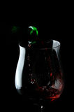 Wine glass. Red drops wine being poured into a wine glass alcohol, being, beverage, bubbles, celebrate, cheers, chill, dinner stock image