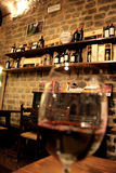 Wine glass. A glass of red wine in a wine shop Royalty Free Stock Photography