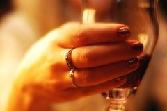 Wine Glass. Closeup view of the hand of a woman holding a wineglass Stock Photography