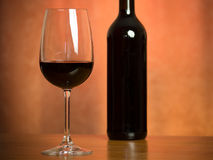 Wine. A glass of wine along with a bottle stock photography