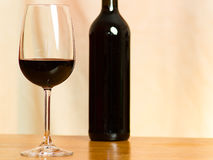 Wine. A glass of wine along with a bottle stock image