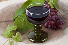 Wine Glass And Grapes Stock Photos
