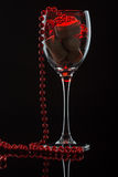 Wine glass with beads Royalty Free Stock Photos