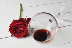 Wine glass and beautiful red rose isolated on white background. petals rose.Copy space. Gift romance day celebration love blossom nature valentine flower floral royalty free stock image