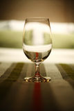 Wine glass on bed Stock Photo
