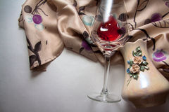 Wine glass on beige patterned background Stock Photography