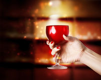 Wine glass being held in a womans hand Stock Image
