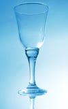 Wine glass on black blue background Royalty Free Stock Photo