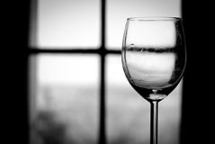 Wine glass in black and white. In medieval restaurant stock image