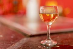 Wine glass on blurred background. Glass with white wine on table. copy space.  stock images