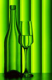 Wine glass and bottle. A green background with wine glass and a bottle Stock Images