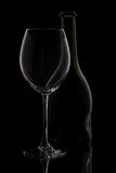Wine glass & bottle. On black Royalty Free Stock Image
