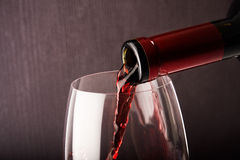 Wine glass and bottle. On dark background Royalty Free Stock Photo