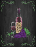 Wine glass and bottle with grapes and vines on chalkboard backgr Royalty Free Stock Photo