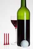 Wine glass and bottle with red wine Stock Images